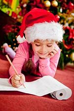 11467024 - girl writing a christmas wish list for santa