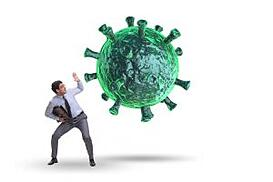 Man fighting a giant COVID-19 virus cell