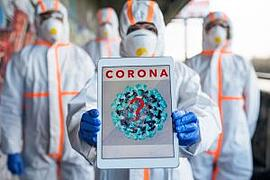Workers in Hazmat suits sharing info on coronavirus