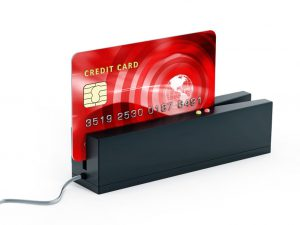 A photo of a credit card being swiped