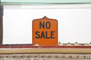 "A photo of a ""No Sale"" sign"