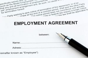 """A piece of paper that is titled """"EMPLOYMENT AGREEMENT"""""""