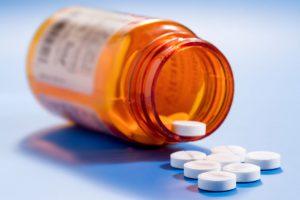 A photo of a bottle of pills.