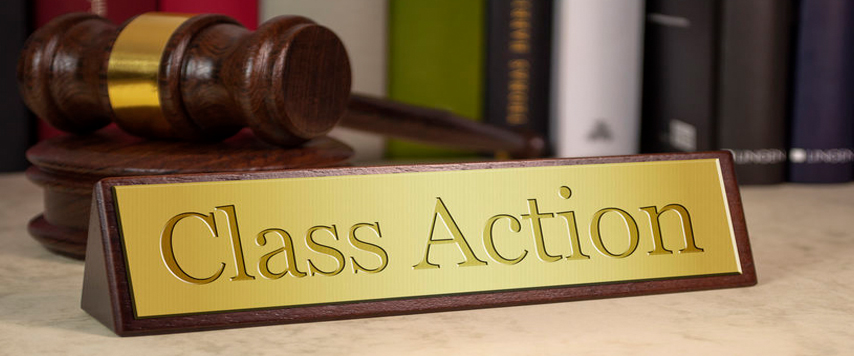 class action sign with a gavel and books